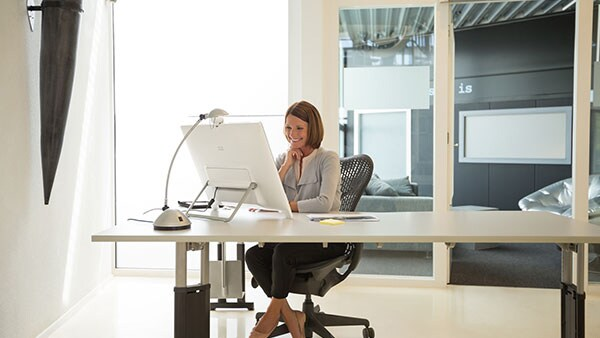 A picture of woman working at a computer