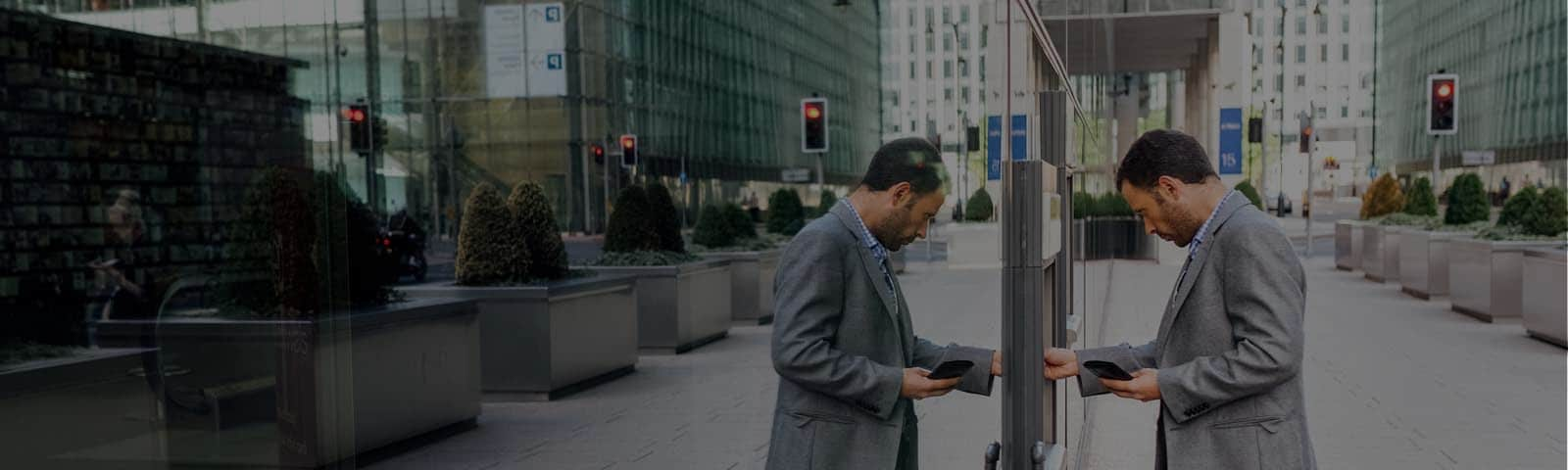 Man using an atm in big city