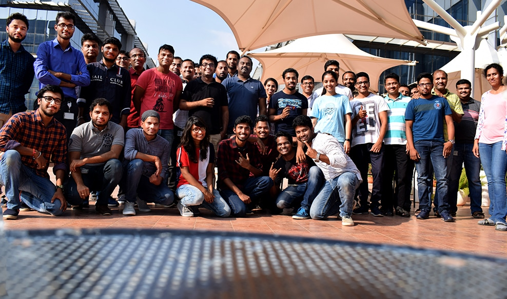 India Engineering team posing and smiling for a large group photo