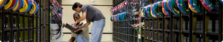 Two men working in a data center
