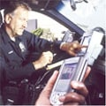 Policeman using technology
