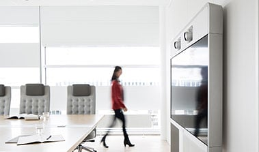 Woman walking in an office