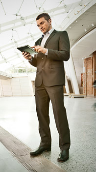 man standing with mobile device