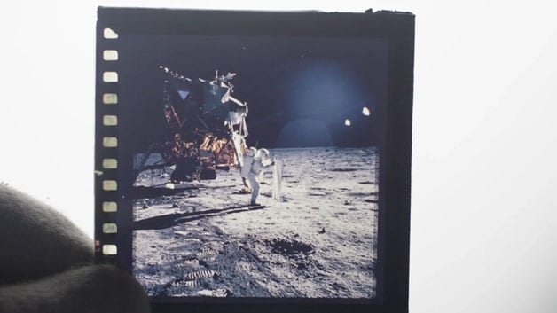 A close-up view of an original moon landing photo slide