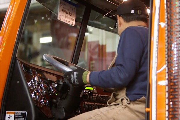 Daimler employee checks the cab of a semi-truck