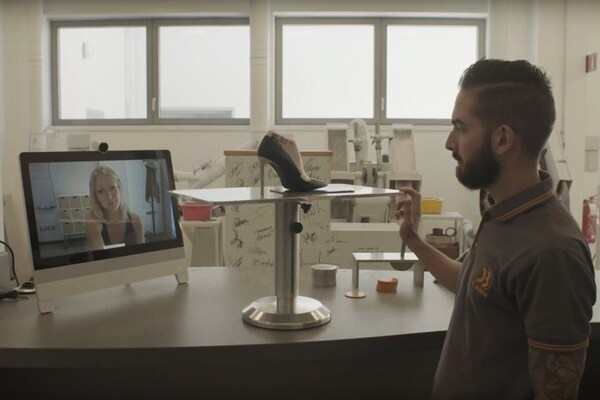 Del Brenta employee using Spark to video conference with a coworker