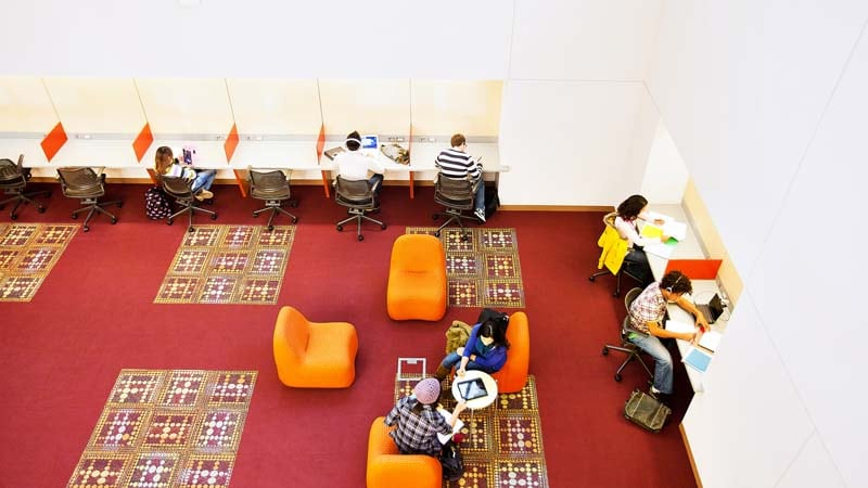 College students use wireless technology in a campus common room