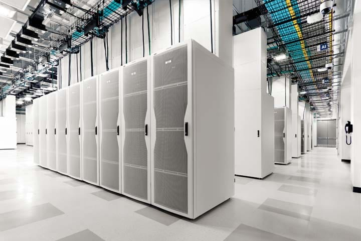 large room with multiple rows of servers
