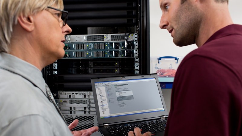 Network managers looking at computer screen