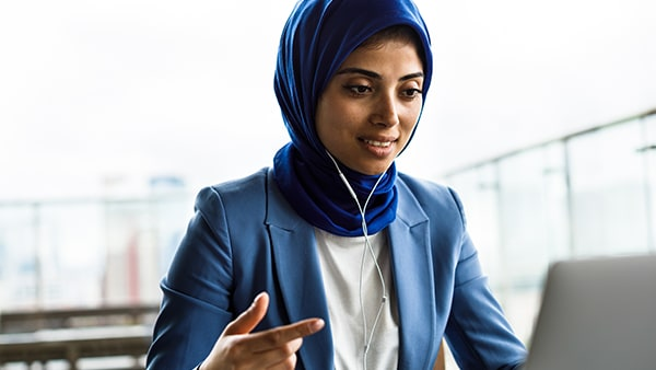 Young professional woman conducting business on laptop