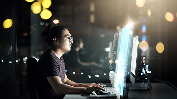 Man working on computer code