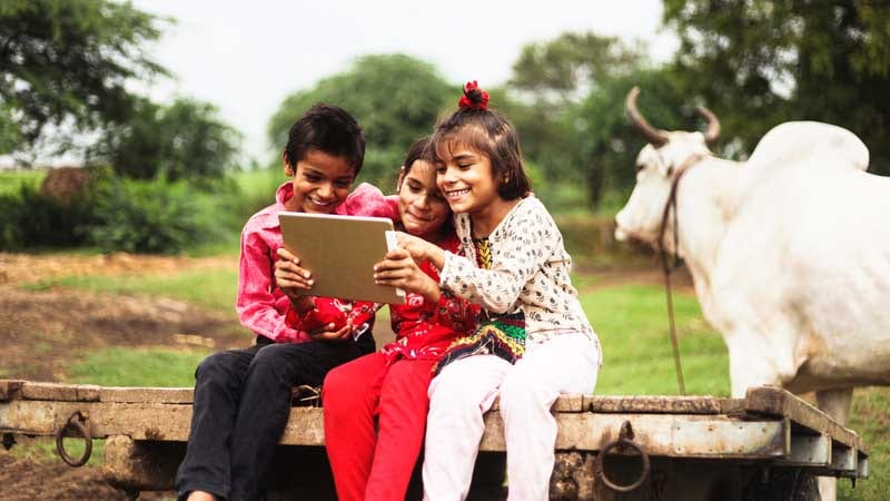 Corporate Social Responsibility - kids using technology