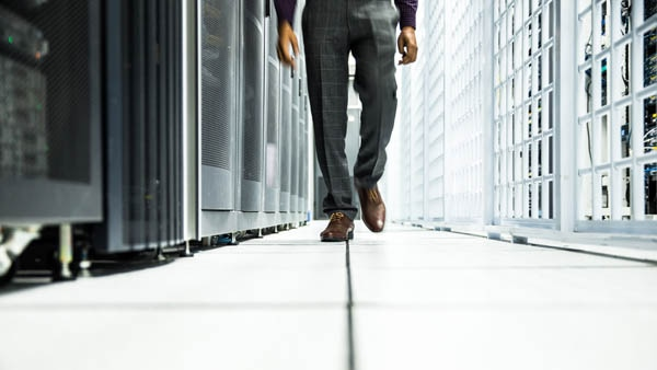 Man walking through a machine learning data center