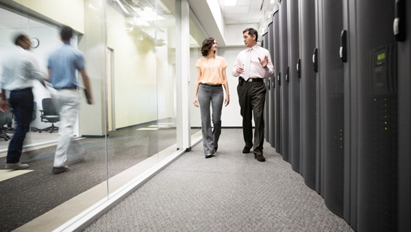 Man and woman walking through a deep-learning data center