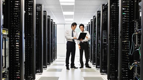 Two employees in the server room