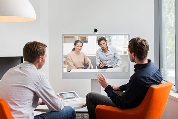 Four people in a teleconference meeting