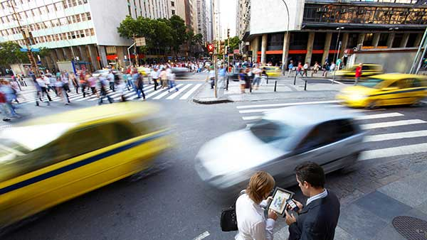 Blurred traffic Image with people collaborating over a tablet