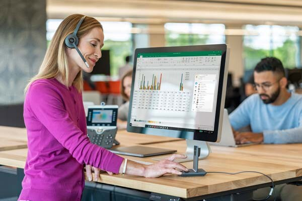 Woman at desk wearing headset