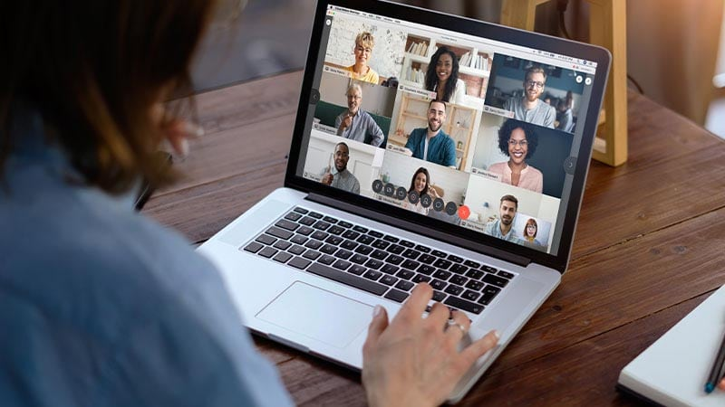 A manager collaborates with her team remotely through a Webex video conference