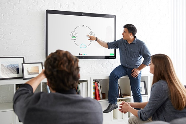 Businessman presents a diagram on a Cisco Webex Board