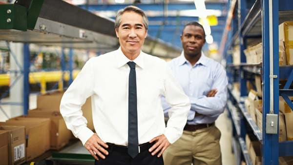 A manager and employee on the factory floor