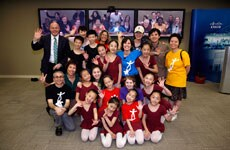 After the performance, dancers in Shanghai and in New York all pose for a picture together