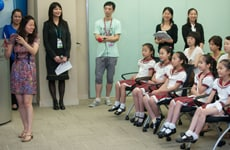 Kathy Chen tells The Shanghai Five's friends and family about the benefits of TelePresence