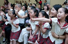 Classmates and family wave to the Shanghai Five in New Jersey
