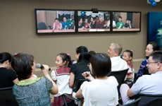 Parents catch up with the Shanghai Five via TelePresence