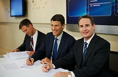 From left to right: David Helliwell, Gregor Robertson, and Scott Fawcett sign a Memorandum of Understanding between the city of Vancouver, Cisco, and Pulse Energy.