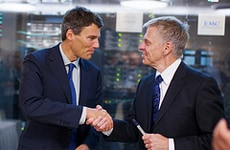 Vancouver Mayor Gregor Robertso, left, shakes hands after the signing of the MOU.