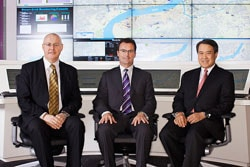 From left to right: Anthony Elvey, Rob Lloyd, and Owen Chan in front of the Community+Exchange Console