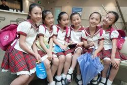 Dancers from the Shanghai Children's Palace get ready to see their friends over TelePresence